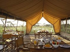 """""""andBeyond Serengeti Under Canvas (from $765 per person per night) is luxurious but not hermetically sealed, balancing colonial and Maasai traditions both in design and in spirit. You still get the bucket shower-bush camp experience—along with surprise three-course picnic lunches made with fresh locally sourced ingredients and cocktails in the middle of the plains. But sometimes it's the ineffable—the feeling of coming back to the warm, attentive staff after several hours in the bush with a…"""