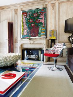 Paris pop art apt living room traditional wall paneling contemporary painting Saarinen Tulip chair