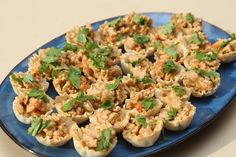 I recently went on a trip to Orville Ohio where I met with Smuckers, a family oriented company that taught me lot of new recipes to try this holiday season. One of them that I actually cooked in their test kitchen was this Peanut Chicken Mini Phyllo Cups Recipe. I had a lot of fun cooking in their kitchen and will be making this recipe for my fa