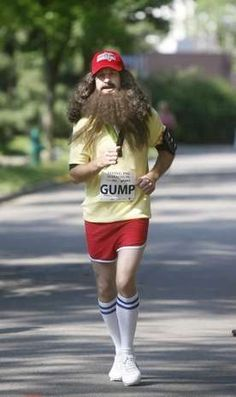 Leigh Taylor  A runner is dressed as Forrest Gump as he runs in Mariemont during the 14th annual Flying Pig marathon.