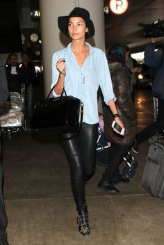 In leather skinnies and studded ankle boots, Lily Aldridge looked every part the rock-star wife as she touched down in Los Angeles. She let a little bit of her Nashville roots show through, though, pairing all that black with a chambray top. Source: FameFlynet