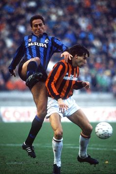 Marco Van Basten shields the ball from Inter's Riccardo Ferri during the Milan Derby