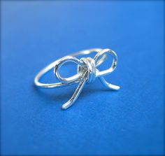 Hey, I found this really awesome Etsy listing at http://www.etsy.com/listing/92147041/sterling-silver-bow-ring-handmade-ring