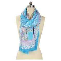 "Art silk scarf with a paisley motif in turquoise and pink.   Product: ScarfConstruction Material: Art silkColor: Turquoise and pinkFeatures: Paisley motifDimensions: 22"" x 72""Cleaning and Care: Hand wash in cold water"