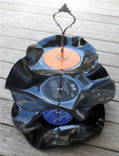 Looking for inspiration to incorporate the groom's father's LP collection into a wedding. Old LP vinyl 3 tier stand