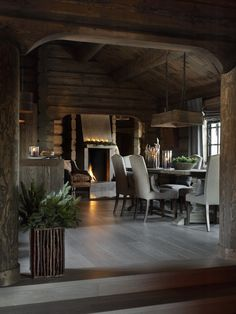 I love this timber interior of this home with the grey flooring and dining suite ~ oozes warmth and style