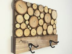 """Wood Slice Art Towel Rack When it comes to decorating, don't leave your bathroom out.  Add a beautiful touch with this stunning piece of art that has a dual function.  Your towels will love you for it. Each rack is hand made using reclaimed wood and will have some slight variations in appearance, but size will always be the same.   Measures 16"""" x 12"""" (1 3/4"""" deep not including hooks).  Hangers included. $49.99"""