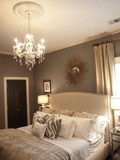 Grey wall color, fabric headboard, bed placement & dark door in master bedroom