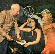 """Marilyn Monroe, Jane Russell and Howard Hawks on the set of Gentlemen Prefer Blondes.  """