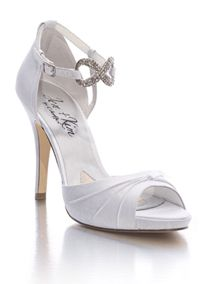 """The infinity ornament on this d'Orsay sandal sits front and Center with the uniquely puckered vamp to create the classiest of bridal and evening shoes. Silk shantung upper and leather sole. Heel: 4 1/2"""" with a 3/4"""" platform. Imported. Jen + Kim for Coloriffics."""