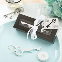 A classic key in silver makes a fabulous table decoration and a useful favor when it is used to open bottles!