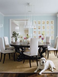Colorful wall, Table, rug, pictures, cool light. Very simple.