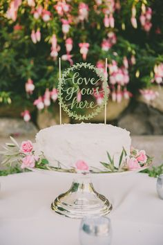 Would love a two tiered rustic cake like this. So pretty. Maybe with white anemones with black center and some greenery? LOVE. Gold or silver topper....