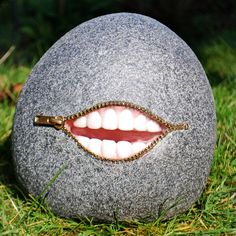 Large Unusual Resin Laughing Stone Garden Ornament With Teeth and Zip