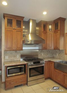 Kitchen remodel in poulsbo wa designed by starmark for Chocolate kitchen cabinets with stainless steel appliances