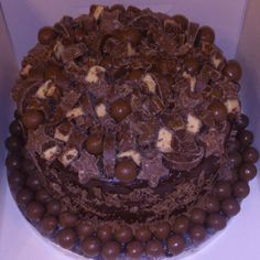 A very chocolate cake for my cousin. Chocolate sponge, filled with choc fudge icing and crushed ripple bars and covered with chopped milkyways, rolos, wish stars, malteasers, choc orange and more galaxy ripple