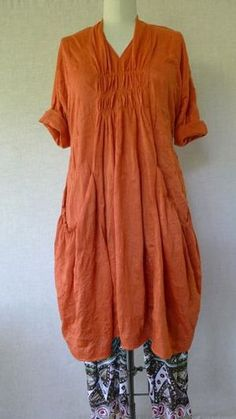 "Marcy Tilton - version of 8813. This one has elastic at the top of the pockets and in the middle of the back. How can you not want something described as ""a vintage french house dress""?"