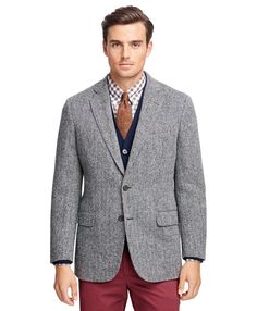 This sport coat is made pure Harris Tweed woven in Scotland. Offered in our Madison Fit which is favored for its relaxed fit, soft shoulders and full chest. Two-button with center vent. Fully lined. Dry clean. Imported.