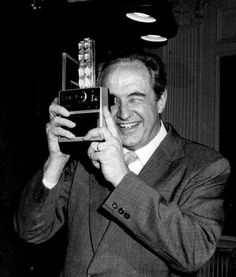 Walter A. Fallon, president of Kodak, holds a new instant camera in New York April 20, 1976, after his company unveiled it. This put Kodak into a market that Polaroid long had had to itself.