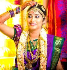 South Indian bride. Temple jewelry.purple and green Silk kanchipuram sari.Braid with fresh flowers. Tamil bride. Telugu bride. Kannada bride. Hindu bride. Malayalee bride