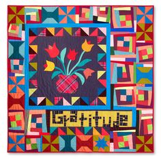 Love this!  Why? - off center medallion - solids - use of one word-  applique and piecing- traditional married with 'wonky'