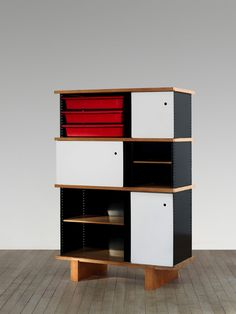 Charlotte Perriand; Ash, Enameled Steel and Plastic Cabinets, 1958.