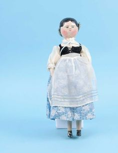 """Wooden Grodnertal type doll, German, mid 19th Century, painted features and hair, mortise and tenon peg joints, some cracking to facial paint, re-dressed, 17""""/43cm."""