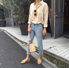 summer: vintage, straight leg denim, flowy blouse, slides/mules beige, bucket bag beige.