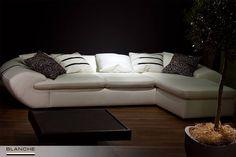 Прекрасным решением для гостиной комнаты станет диван Caffi от Blanche™. К его достоинствам следует отнести современный дизайн, непременно сочетающий в себе удобство за счет глубокой посадки, и, конечно же, обивку из высококачественной итальянской кожи коллекции Sanremo.