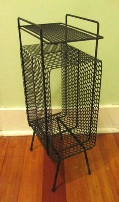 I have this exact same Mid Century Modern telephone stand. $45.00, via Etsy. Paid $8 at a garage sale:)