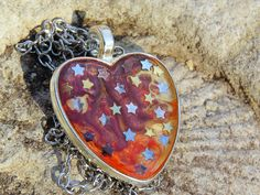 Valentine's Day necklace, galaxy heart pendant, resin jewelry https://www.etsy.com/listing/506519381/red-swirl-heart-with-stars-space