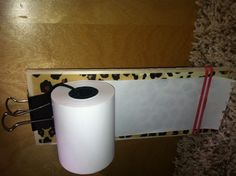 Leopard notepad roll.  Easy to do with: wood, paint, modge podge, craft paper, shoe laces, receipt rolls, clips, rubber bands.