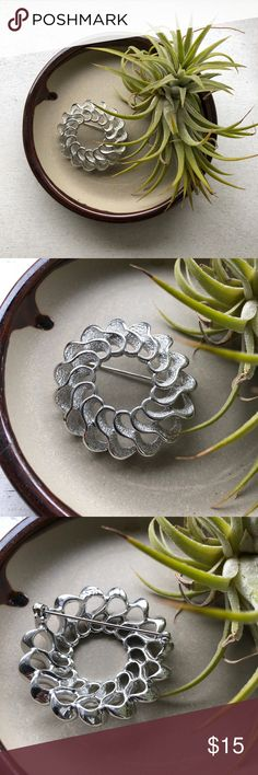 Vintage silver Sarah Coventry brooch Vintage silver plated flower brooch.   Sarah Coventry Filigree silver plated brooch  Unique and one of a kind in perfect condition   Size indicated in pictures  Shipping combined when bundled with other brooches Sarah Coventry Accessories