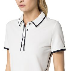 Tommy Hilfiger women's polo. A best-seller year after year-our iconic polo in a fresh new palette. Styled in a fitted silhouette with just enough stretch to skim the curves comfortably.• Classic fit.• 100% cotton. • Machine washable. • Imported.