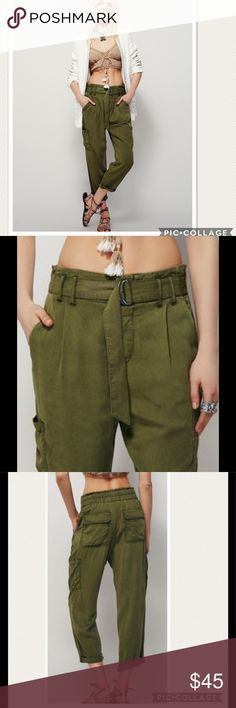 "NWT Free People Summers Crop Cargo Pants Super soft cargo style pants with a smocked elastic waistband in back and adjustable belt for an easy effortless fit. Four-pocket style with a hidden button fly and causal cuffed hem.  100% Rayon Machine Wash Cold #119 Waist 32"" Rise 13"" Inseam 25"" Free People Pants Ankle & Cropped"