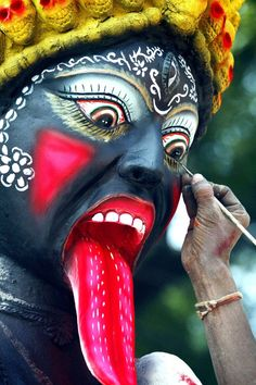 Navratri, Durga Puja: Worshipping The Divine Mother - Touching up a statue of Kali
