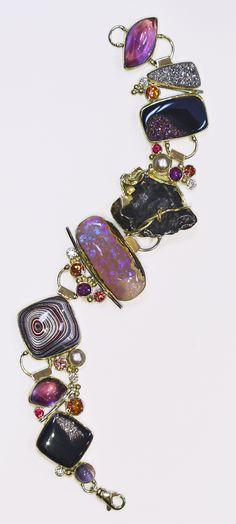 Opalized coral bracelet with fordite, meteorite, diamonds, amethyst, topaz in 22k and 18k. by Jennifer Kalled; Boulder opal from Bill Kasso, Eagle Creek Opal.