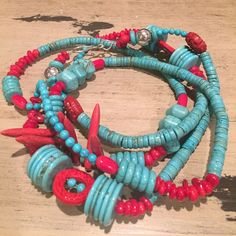 Turquoise, sterling, coral necklace 52 inches long. Sterling silver hook and eye clasp. Sterling silver balls. Red cinnabar. Red coral. Chunky turquoise. Can be worn many ways.  Single, doubled, even tripled. Handmade. Jewelry Necklaces