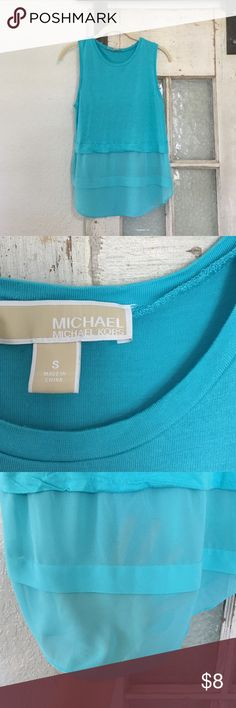 Michael Kors tank top Gently used Michael Kors tank top. Bottom portion slightly see through. Size small. MICHAEL Michael Kors Tops Tank Tops