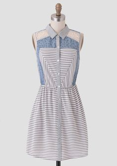 This darling button-up dress features a white and gray striped pattern at the skirt and bodice with contrasting blue panels adorned with a ditzy floral print in hues of green and purple. Accent...