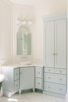Blue bathroom features a blue corner washstand painted Benjamin Moore Woodlawn Blue topped with white marble and a bowl sink under an Allen + Roth Hovan Arch Frameless Mirror illuminated by a three light sconce alongside a mosaic marble floor. Bathroom Vanity Chair, Bathroom Vanity Lighting, Bathroom Furniture, Bathroom Interior, Master Bathroom, Corner Sink Bathroom, Relaxing Bathroom, Shiplap Bathroom, Bathroom Sinks