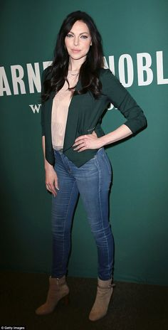 While the green of the Irish flag (sometimes called Shamrock green or spring green) is the official color of St. Patrick's day ¿ fashion has no rules. Variations of the shade like Laura Prepon's hunter colored blazer by Bebe makes a festive statement