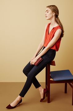 For evening, pair Ann Taylor's High Rise Jean with a colorful top, suede kitten heels and a sweet red clutch.