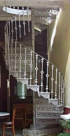 A cast iron spiral staircase clearly showing the central newel post that support. A cast iron spiral staircase clearly showing the central newel post that supports the treads, risers and balustrade. Wrought Iron Stair Railing, Beautiful Stairs, Newel Posts, Take The Stairs, Stair Steps, Stairway To Heaven, Staircase Design, Architecture Details, Interior Architecture