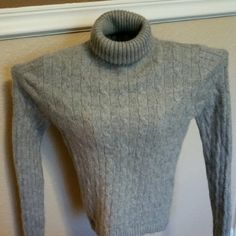 Lord & Taylor Grey Authentic Cashmere Sweater So soft and comfortable, fit is perfect.  Size small ,with versatile neck. Authentic 2 ply cashmere, complete luxury to the touch...A must have for Fall ,winter or spring wardrobe.  Dress it up for work, or adorable with jeans and knee boots for fun? Priced to sell..excellent condition, no tears,stains or defects...comes from a pet free smoke free extremely clean home ? Lord & Taylor Sweaters Cowl & Turtlenecks