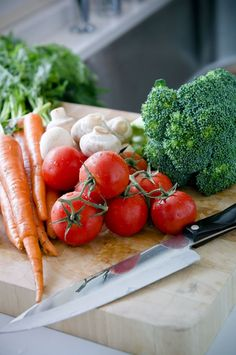 Tomatoes, broccoli, and carrots are three vegetables shown to have improved nutrient value when cooked.