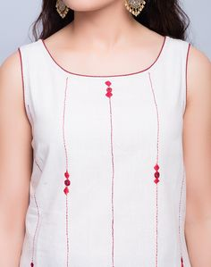 Make a style statement with this knee length tunic style kurta made using cotton fabric. This kurta features soof embroidery with mirror work make this kurta perfect for special occasions. Cotton Fabric Soof Embroidery Mirror Work Boat Neck Sleeveless Hand Wash Separately in Cold Water