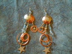 Mixed metal earrings  celestial dangles on Etsy, $35.00