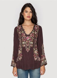 Fabio Blouse The Johnny Was FABIO BLOUSE embodies gypset style! This boho blouse features a stunning embroidery design that combines floral and geometric elements decorating the front, back, and long bell sleeves. For a 1970s-inspired look, tuck the FABIO BLOUSE into high-waisted flares!  - Rayon Georgette - Keyhole Tie Neck with Three Button Closure, Long Bell Sleeves - Signature Embroidery - Care Instructions: Machine Wash Cold, Tumble Dry Low