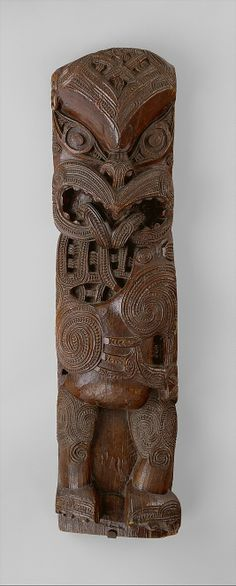 A carved-wood Maori house-post figure (amo), an ancestor image, this figure may depict an ancient warrior with his tongue thrust out in defiance and threat. (Metropolitan Museum of Art) Maori Tribe, Maori People, Long White Cloud, Polynesian Art, Maori Designs, New Zealand Art, Nz Art, Art Premier, Maori Art